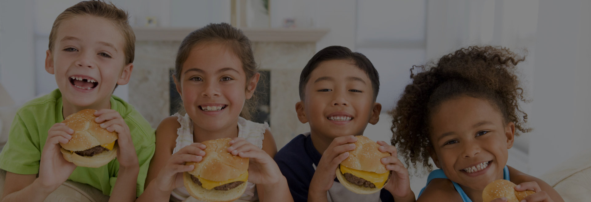 children eating hamburgers